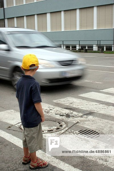 Child on a pedestrian crossing