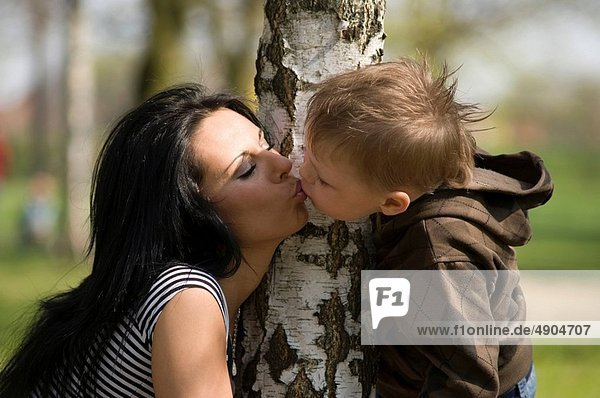 Mutter kissing son