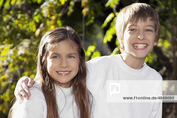 Portrait of a boy smiling with his sister