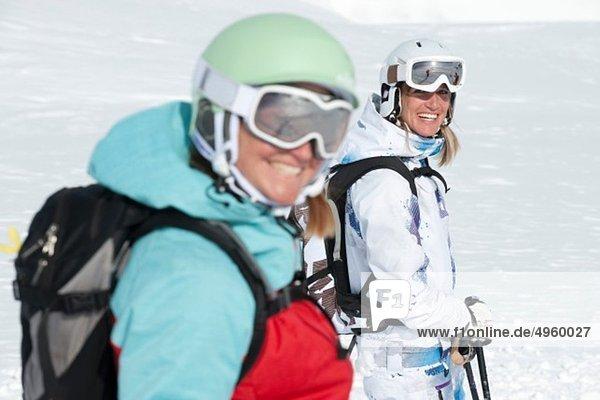 Austria  Kleinwalsertal  Women wearing ski goggles  smiling
