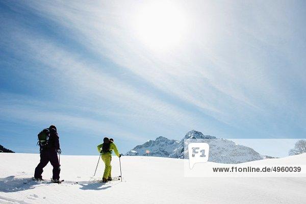 Austria  Kleinwalsertal  Couple skiing