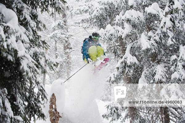 Austria  Kleinwalsertal  Male skier jumping mid-air