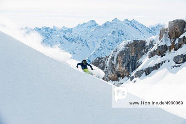 Austria  Kleinwalsertal  Man skiing