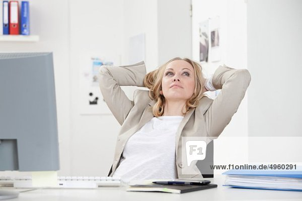 Businesswoman relaxing in office  smiling