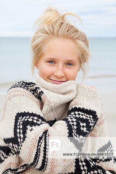 Teenage girl standing on beach  portrait