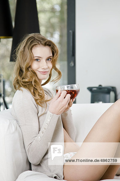 woman drinking fruit tea