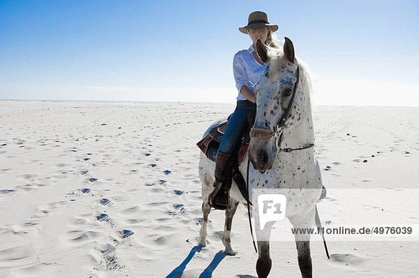 Reiten im Sand