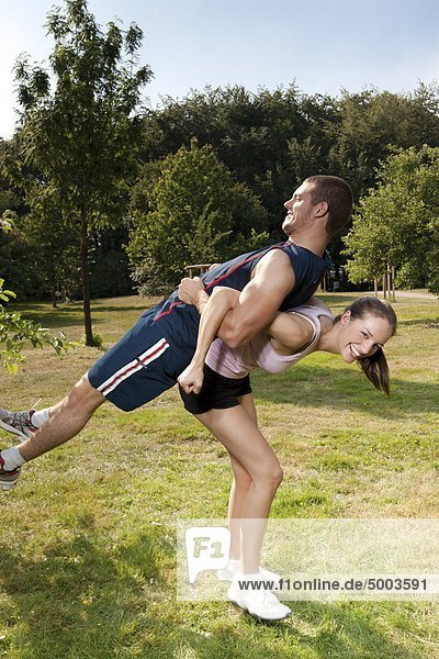 Athletic young couple outdoors
