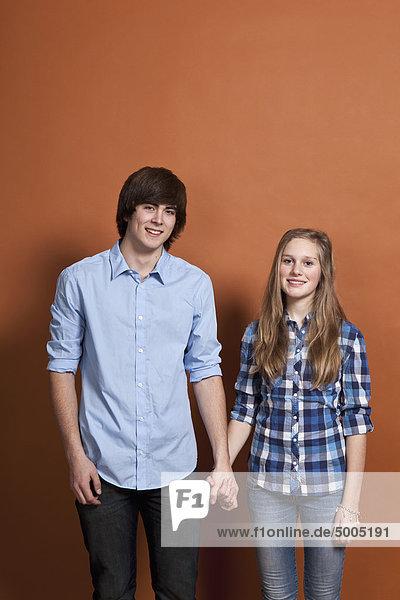 A teenage  heterosexual couple  portrait  studio shot