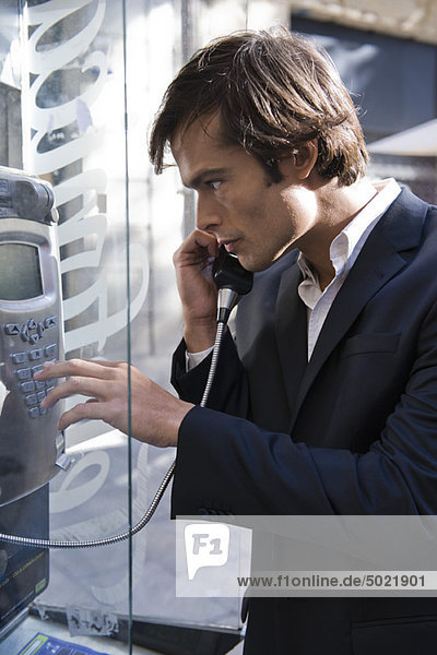 Man using pay phone