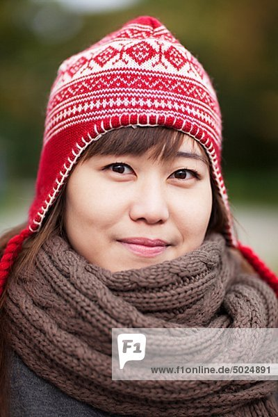 Portrait of happy young woman wearing wooly hat