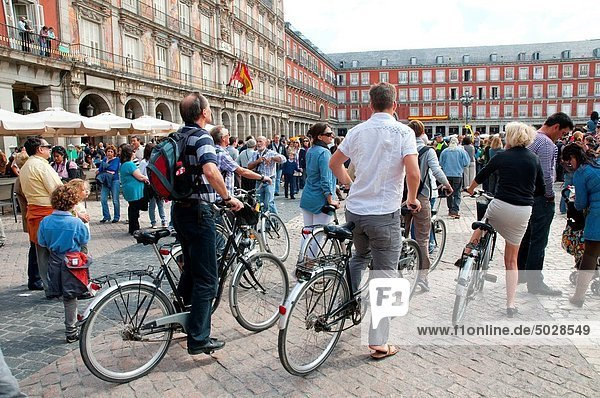 Group of tourists riding bikes  Main Square. Madrid  Spain.