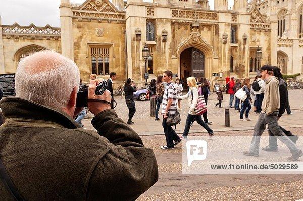 A man taking photos with his digital camera in Cambridge   Cambridgeshire   England   Britain   Uk