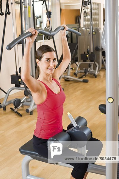 Woman exercising at a health club