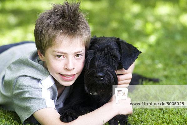 Boy with dog in grass  Munich  Bavaria  Germany