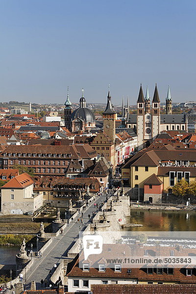 Germany  Bavaria  Lower Franconia  Würzburg  View of old bridge and church with main river