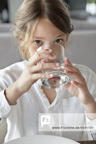 Portrait of a girl drinking water