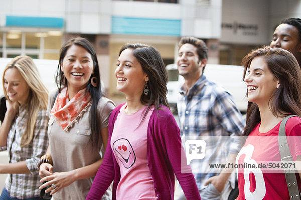 Smiling friends walking together