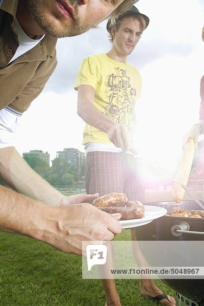 Young people at barbecue