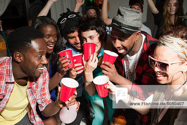 Young people with plastic cups at party