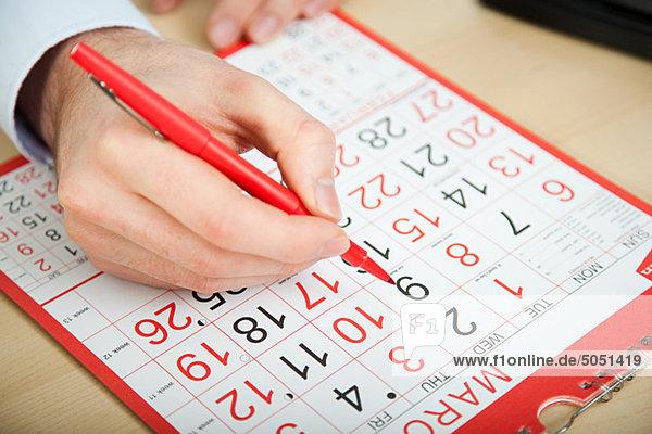 Bürobeschriftungskalender mit rotem Stift