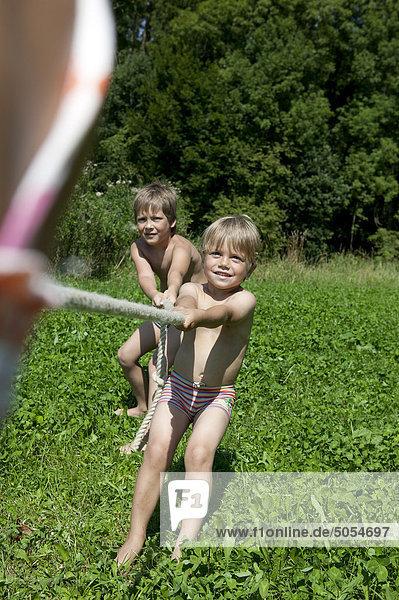 two boys playing tug-of-war