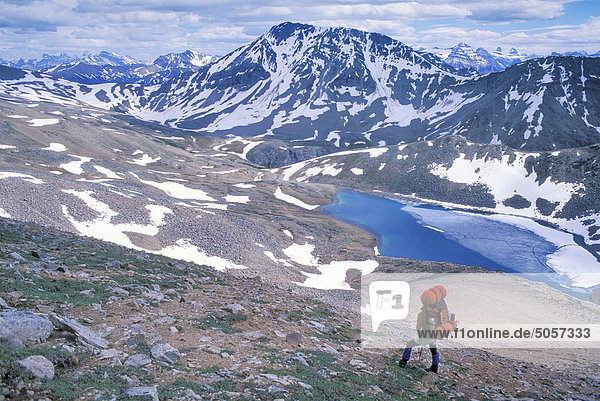 Lone female backpacker on Skyline Trail  Jasper National Park  Alberta