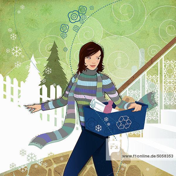 Frau trägt Recyclingbehälter im Winter Frau trägt Recyclingbehälter im Winter