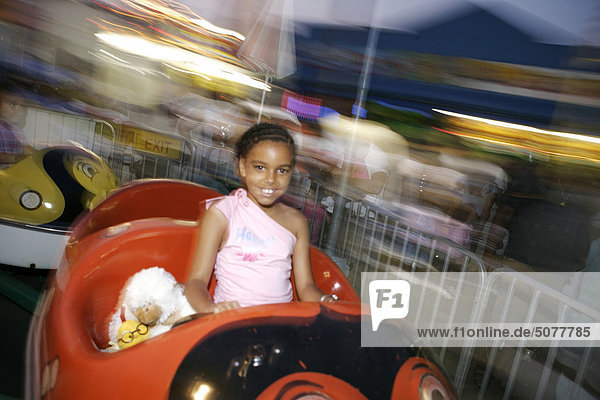 Usa  New York  Coney Island  girl at amusement park on carousel