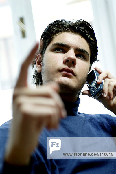 Man on the phone pointing with forefinger