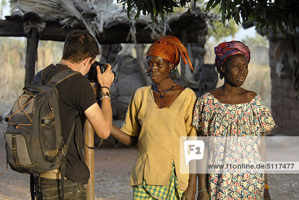 Africa  Burkina Faso  photographer taking women picture