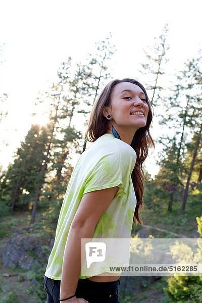 A happy young caucasian woman outdoors