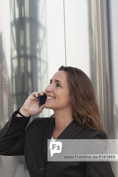 Close up of businesswoman on cell phone