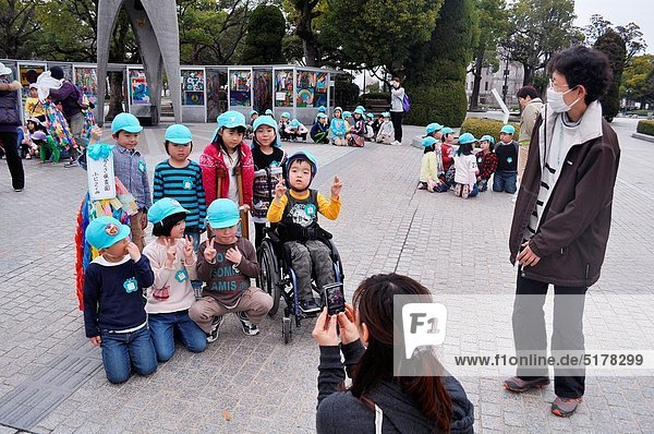 Hiroshima (Japan): school children posing for a photo by the Peace Memorial Park