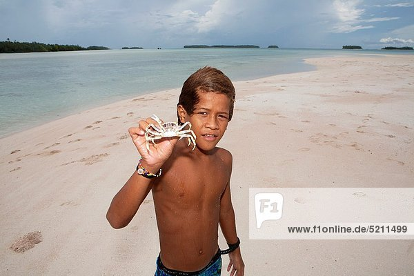 Boy on Tuvalu  island in the Pacific