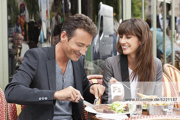 Couple enjoying lunch at a restaurant  Paris  Ile-de-France  France