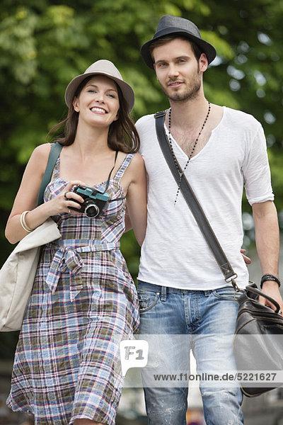 Couple walking on a road and smiling  Paris  Ile-de-France  France