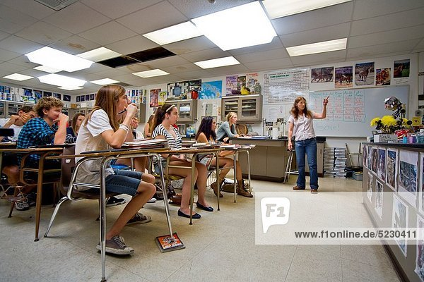 A high school chemistry teacher addresses her class in San Clemente  CA