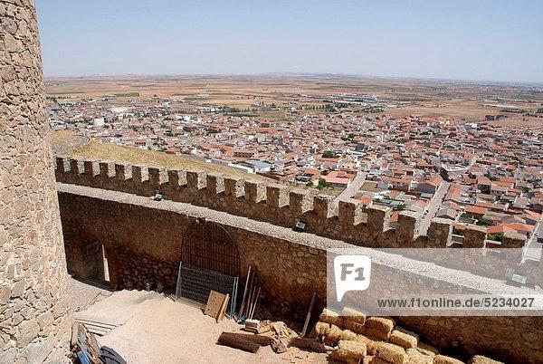 Wall of the Castle and the town of Consuegra Consuegra background  Toledo  Castilla La Mancha  Spain