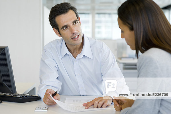 Financial advisor meeting with client