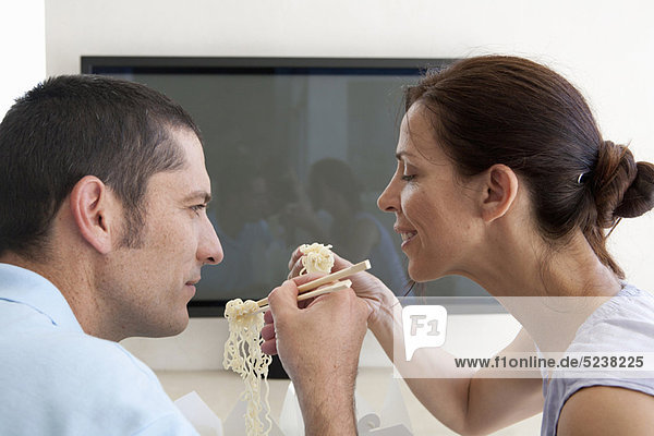 Couple eating Chinese take out