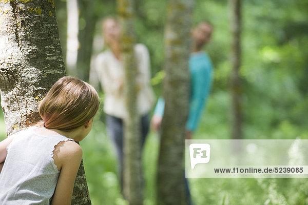 Girl Hiding Behind Baum
