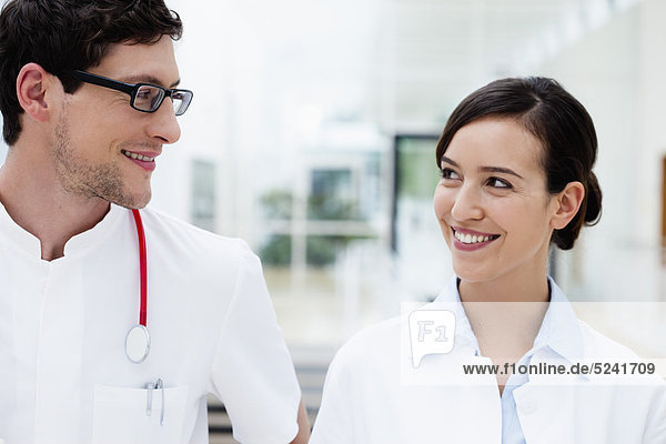 Germany  Bavaria  Diessen am Ammersee  Two young doctors with stethoscope  smiling