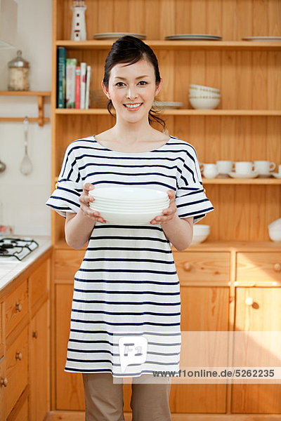 Woman holding dishes  portrait