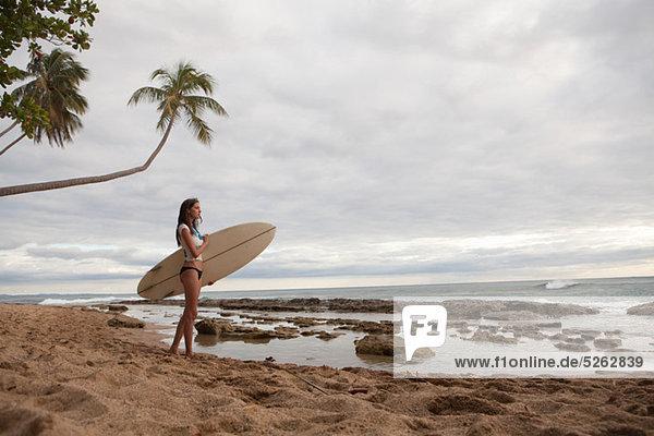 Young Woman Holding Surfbrett  portrait