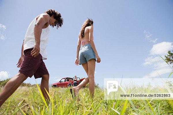 Young Couple walking through Gras