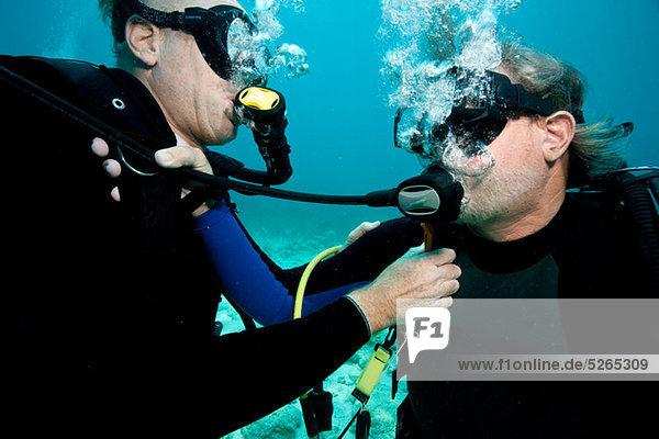 Scuba divers share air