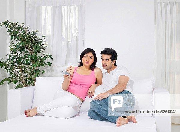 Couple using remote control   MR779L   MR779M