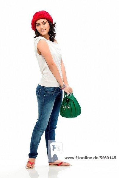 Portrait  Frau  Tasche  halten