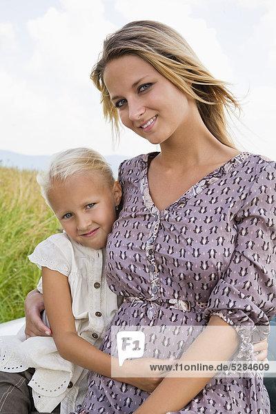 Porträt der jungen Frau und Tochter